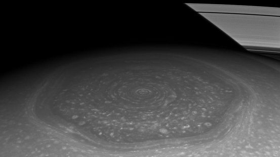 What drives the hurricane-like vortices at each of Saturn's poles?