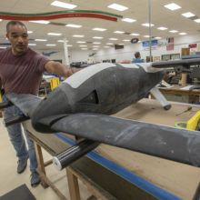 Sam James assembling a 3-D printed LA-8 Aerodrome.