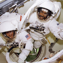 1280px-bernard_harris_and_michael_foale_prepare_to_leave_airlock_-_gpn-2006-000022