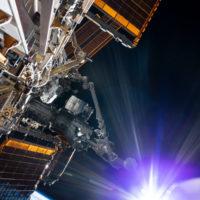 The_sun_beams_during_a_spacewalk_card_full