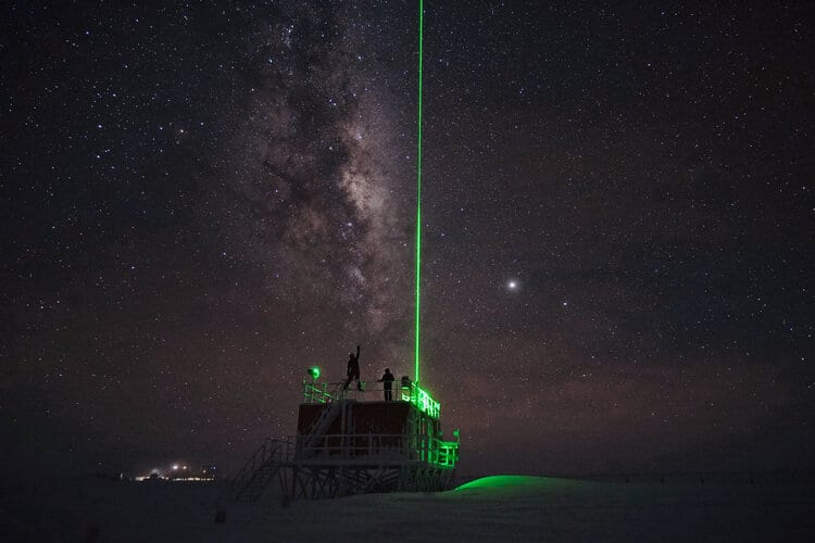 A laser shoots into the sky to study the Antarctic atmosphere at Concordia research station